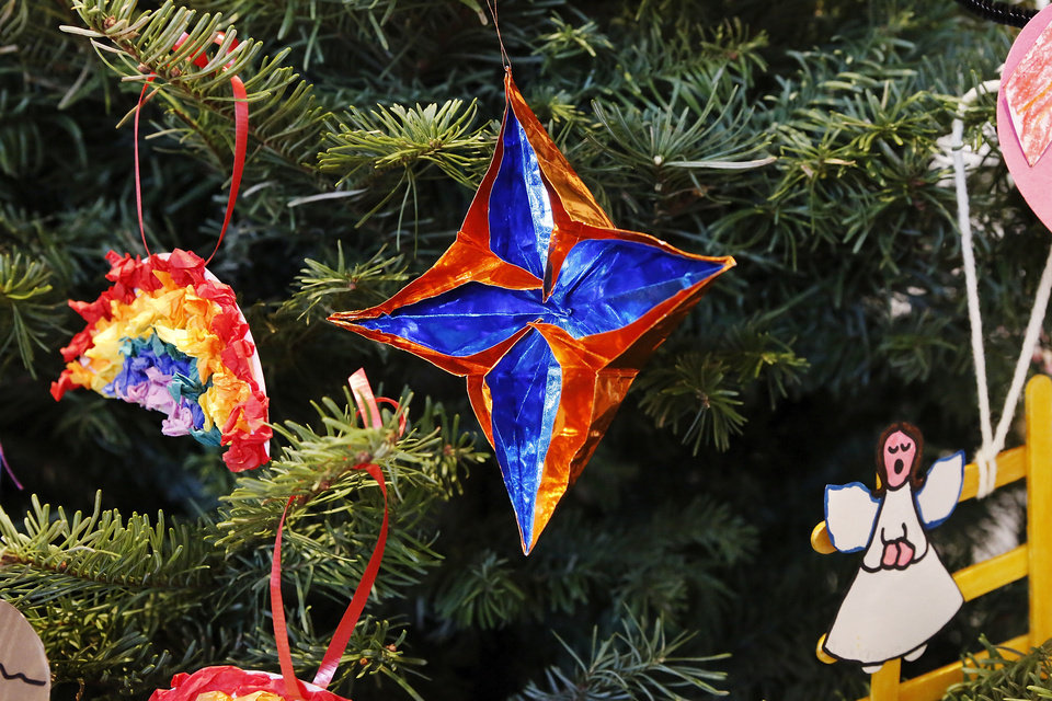 An origami ornament of the Star of Bethlehem represents the Magi on the Jesse Tree at St. James Catholic School in south Oklahoma City.