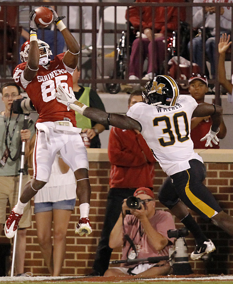 Photo - Oklahoma's Ryan Broyles (85) catches a touchdown pass in front of Missouri's Keronte Walker (30) during the college football game between the University of Oklahoma Sooners (OU) and the University of Missouri Tigers (MU) at the Gaylord Family-Memorial Stadium on Saturday, Sept. 24, 2011, in Norman, Okla. Photo by Chris Landsberger, The Oklahoman