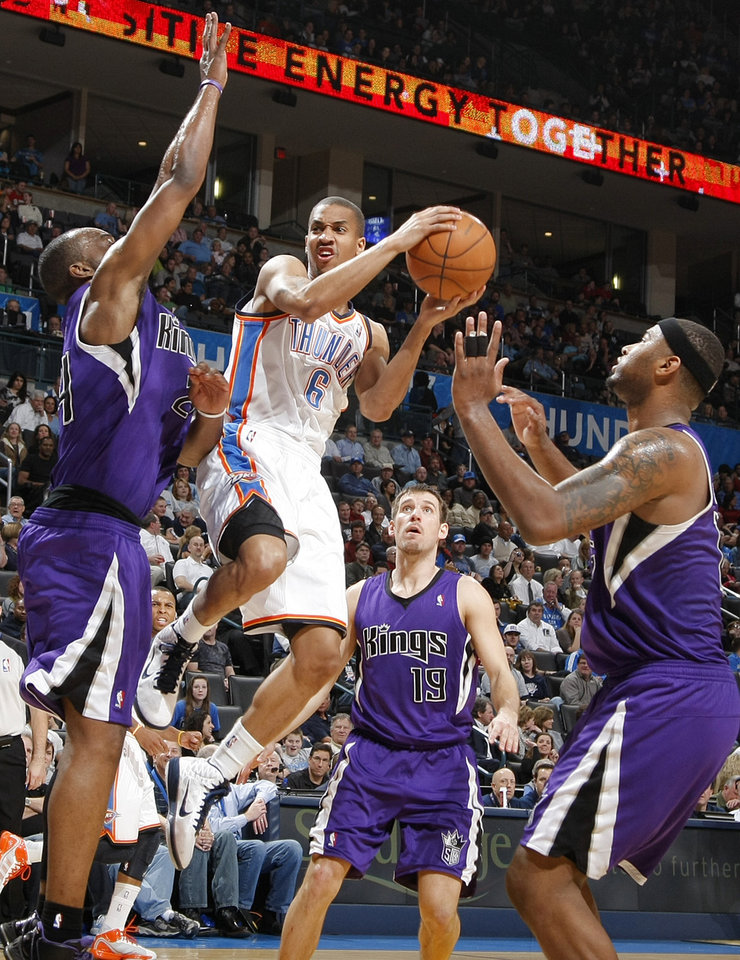 The Thunder\'s Eric Maynor (6) drives into the paint against the Kings\' Carl Landry (24) during the NBA basketball game between the Oklahoma City Thunder and The Sacramento Kings on Tuesday, Feb. 15, 2011, Oklahoma City Okla. Photo by Chris Landsberger, The Oklahoman