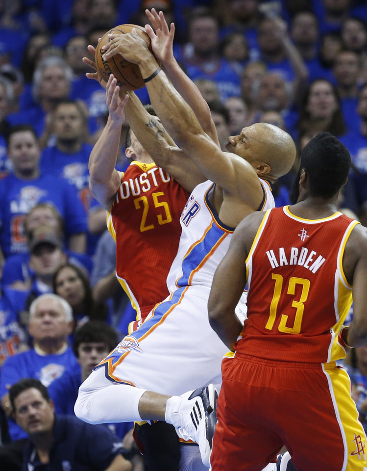 Oklahoma City Thunder guard Derek Fisher is blocked by Houston Rockets forward Chandler Parsons (25) in the second quarter of Game 5 of a first-round NBA basketball playoff series in Oklahoma City, Wednesday, May 1, 2013. Rockets guard James Harden is at right. (AP Photo/Sue Ogrocki)