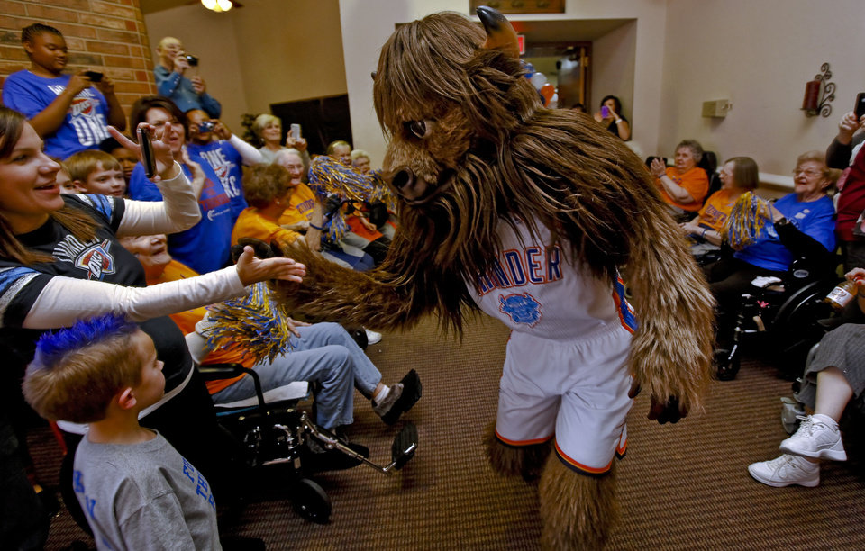 Rumble is greeted by fans Leslie and Kohen Wafer at Ranchwood Nursing Home, during the Oklahoma City Thunder's 1,000th community appearance.   Photo by Chris Landsberger, The Oklahoman <strong>CHRIS LANDSBERGER - CHRIS LANDSBERGER</strong>
