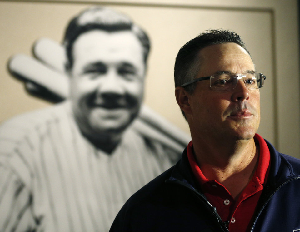 Photo - Former Atlanta Braves pitcher Greg Maddux visits a Babe Ruth exhibit during his orientation visit at the Baseball Hall of Fame on Monday, March 24, 2014, in Cooperstown, N.Y. Maddux will be inducted to the hall in July. (AP Photo/Mike Groll)
