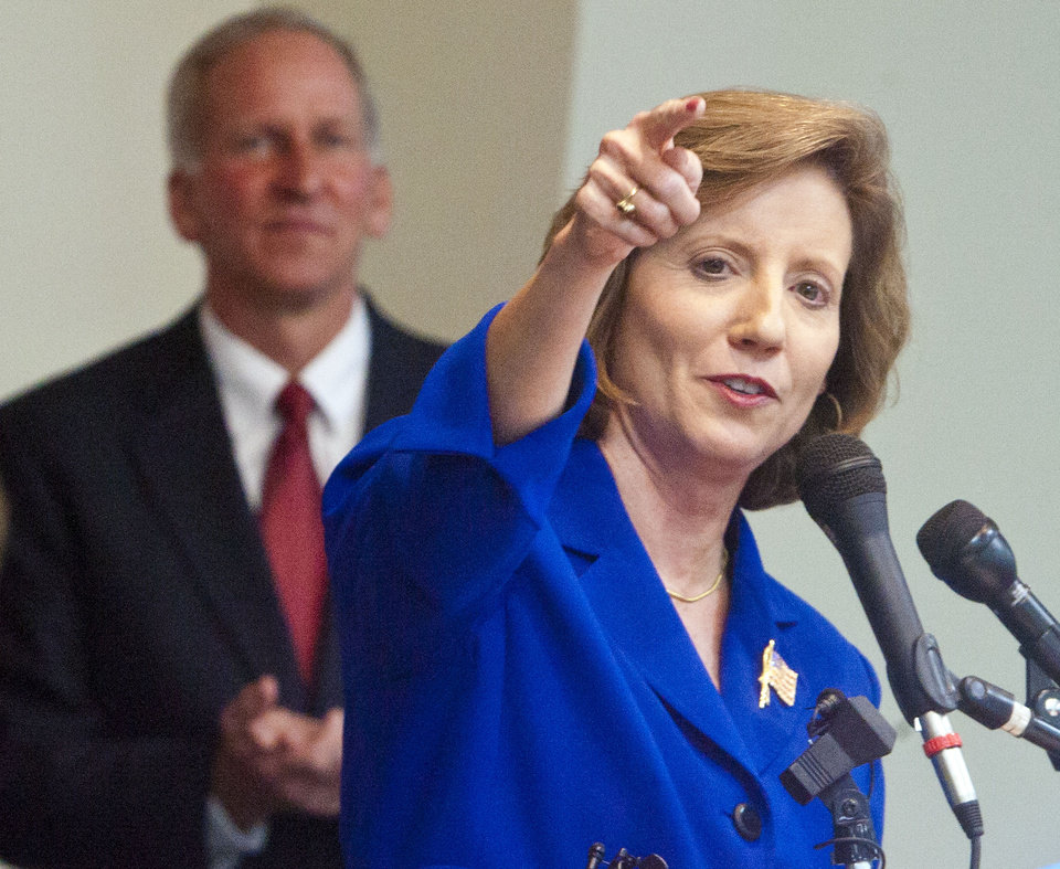 Photo -   Republican Vicky Hartzler, with her husband Lowell Hartzler, speaks to supporters after winning the Missouri 4th Congressioinal Distict seat over Democratic challenger Teresa Hensley on Tuesday, Nov. 6, 2012 in Harrisonville, Mo. (AP Photo/The Kansas City Star, Allison Long)