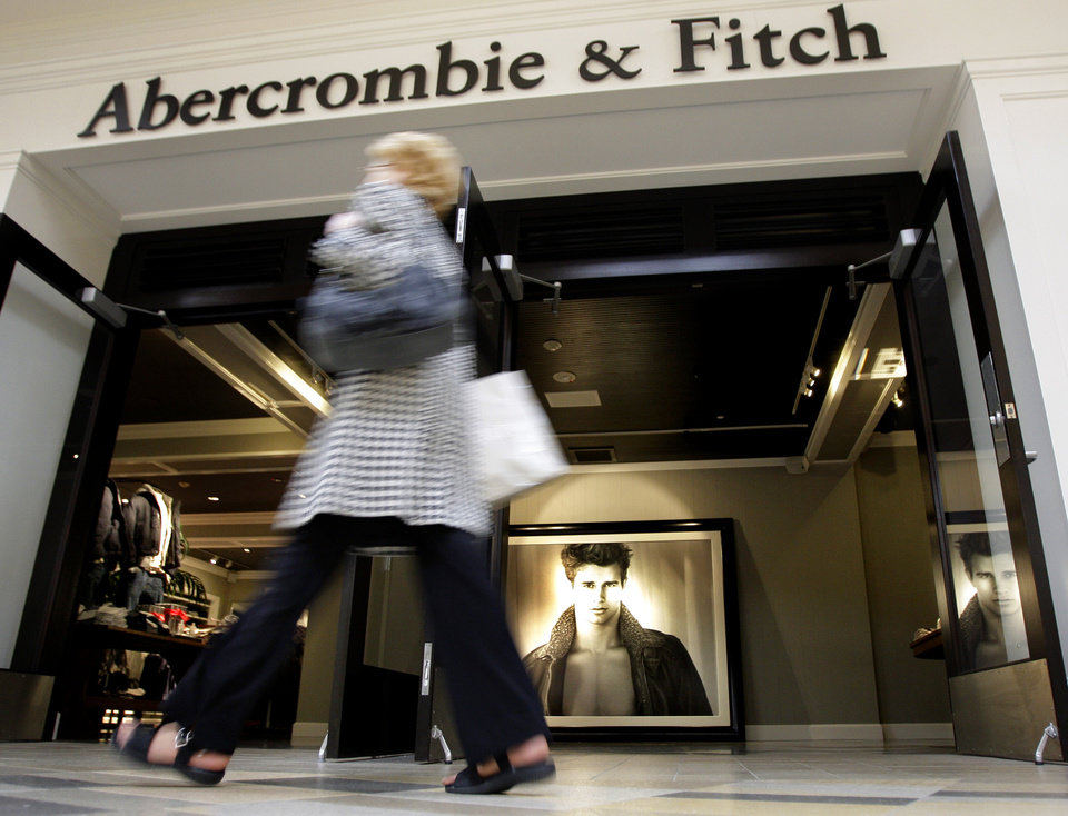 FILE - In this Thursday, Dec. 4, 2008, file photo, a shopper hurries past the Abercrombie & Fitch store at Beachwood Place Mall in Beachwood, Ohio. Abercrombie & Fitch Co. delivered a pleasant pre-Christmas surprise to investors: the teen retailer raised its full-year earnings earnings guidance on a strong third-quarter performance, sending shares surging. The company, based in New Albany, Ohio, reported a 41 percent increase in its net income for the third quarter as international, domestic and direct-to-consumer sales strengthened. Its results beat Wall Street expectations.(AP Photo/Amy Sancetta)