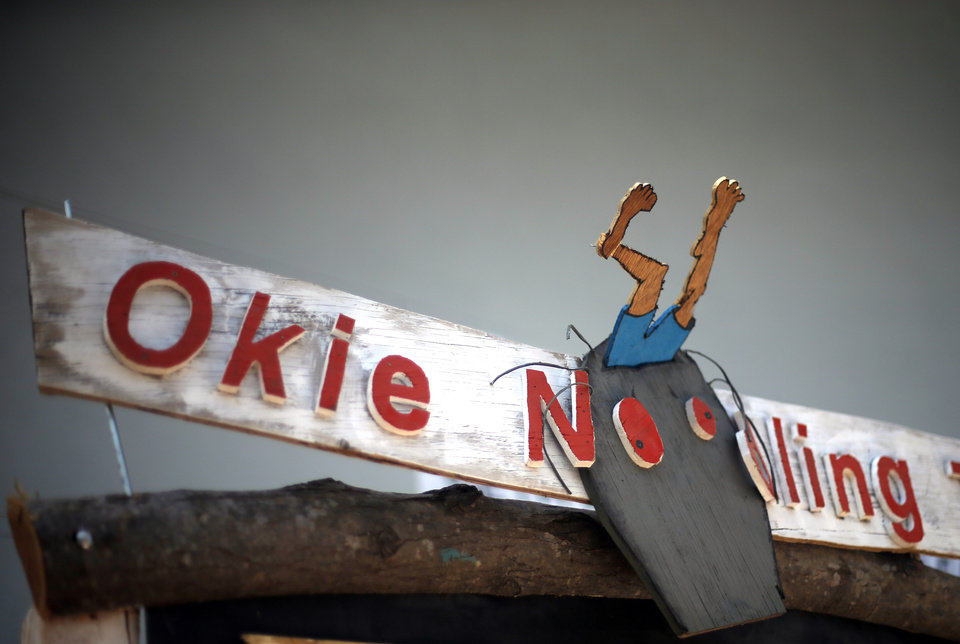 A sign is pictured on stage during the 14th annual Okie Noodling Tournament at Wacker Park in Pauls Valley, Okla., Saturday, June 22, 2013. Photo by Sarah Phipps, The Oklahoman