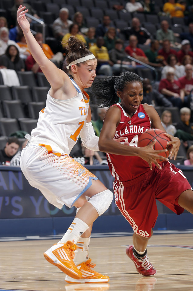 Oklahoma\'s Sharane Campbell (24) tries to get around Tennessee\'s Taber Spani (13) during the college basketball game between the University of Oklahoma and the University of Tennessee at the Oklahoma City Regional for the NCAA women\'s college basketball tournament at Chesapeake Energy Arena in Oklahoma City, Sunday, March 31, 2013. Photo by Sarah Phipps, The Oklahoman
