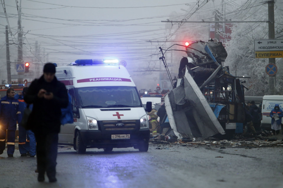 Photo - FILE - In this Monday, Dec. 30, 2013 file photo an ambulance leaves the site of an explosion after a bomb blast tore through the trolleybus, background, in the city of Volgograd. A series of unexplained killings in southern Russia involving booby-trapped bombs has further heightened security fears ahead of next month's Winter Olympics in Sochi. A spokesman for Russia's main investigative agency, said in a statement that no motive had yet been found for killings on Wednesday Jan. 8, 2014 on the outskirts of Pyatigorsk, which is the center of an administrative district created in 2010 to coordinate efforts to combat the insurgency.  (AP Photo/Denis Tyrin, File)