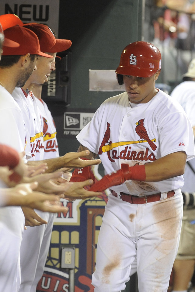 Photo - St. Louis Cardinals' Kolten Wong, right, is congratulated by teammates after his solo home run against the Boston Red Sox in the fifth inning in a baseball game, Thursday, Aug. 7, 2014, at Busch Stadium in St. Louis. (AP Photo/Bill Boyce)