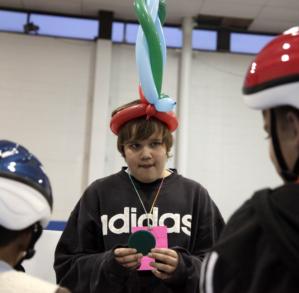 Photo - Volunteer Caleb Elsea, 13, from Highland East, asks riders questions at the bicycle rodeo at the Moore Fun Safety Fair in the Moore Community Center Saturday, May 2, 2009. Photo by Doug Hoke, The Oklahoman