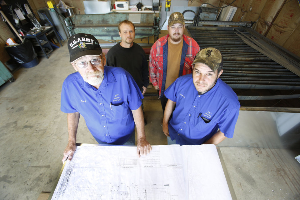 Photo - Doug Tolliver (left), owner of Masters Heating & Air in Del City, is paying the base monthly retainer of a startup medical care company for any worker who wants it. Tolliver and, from left, employees Jeremie Sims, Tommy Henderson and Mike Sims pose in the business' sheet metal shop. Photo By Steve Gooch, The Oklahoman  Steve Gooch