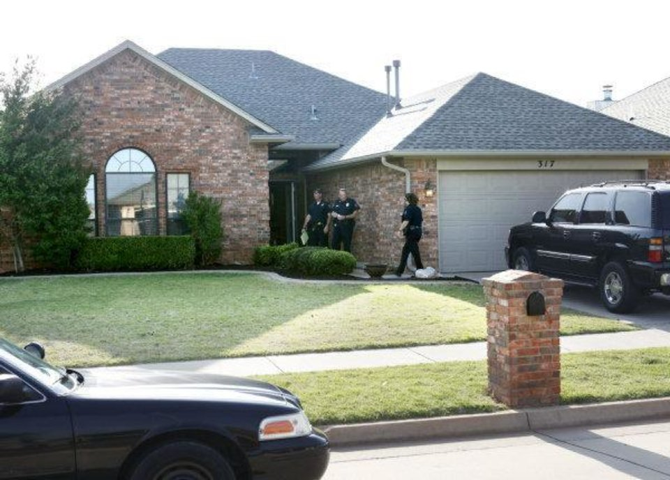 Photo - Yukon police investigate a shooting, 317 Sunrise Drive, in Yukon involving a Piedmont police officer who shot a retired Yukon firefighter who pushed his way inside the home.  PAUL HELLSTERN