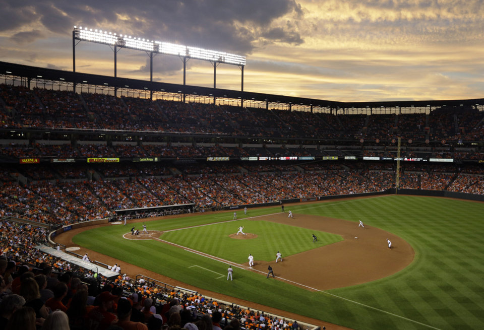 Photo - The sun sets behind Oriole Park at Camden Yards in the fifth inning of an interleague baseball game between the Baltimore Orioles and the Washington Nationals, Wednesday, July 9, 2014, in Baltimore. (AP Photo/Patrick Semansky)