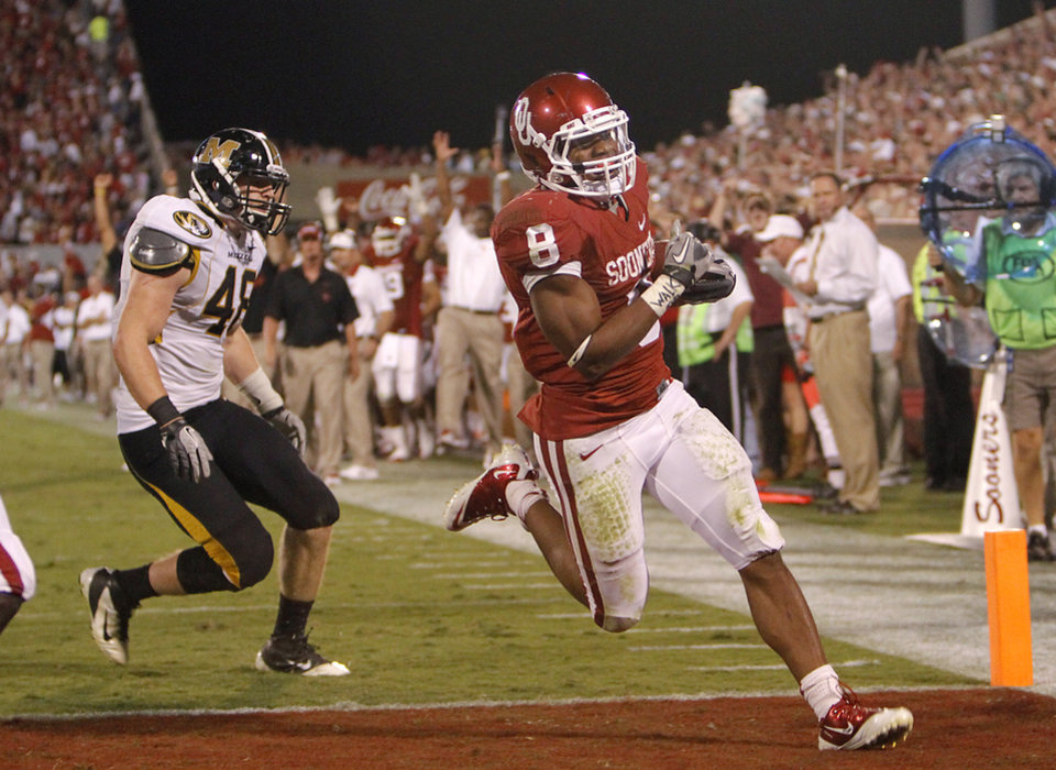 Oklahoma's Dominique Whaley (8) runs in for a touchdown during the college football game between the University of Oklahoma Sooners (OU) and the University of Missouri Tigers (MU) at the Gaylord Family-Memorial Stadium on Saturday, Sept. 24, 2011, in Norman, Okla. Photo by Chris Landsberger, The Oklahoman