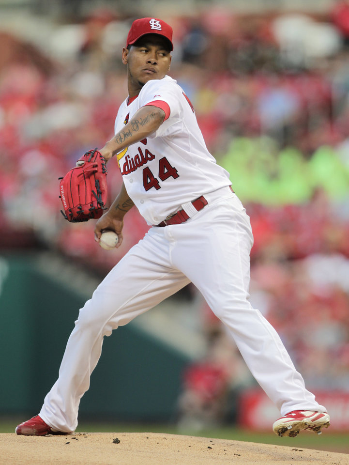 Photo - St. Louis Cardinals starting pitcher Carlos Martinez (44) sets to deliver a pitch in the first inning of a baseball game against the Pittsburgh Pirates, Tuesday, July 8, 2014, in St. Louis. (AP Photo/Tom Gannam)