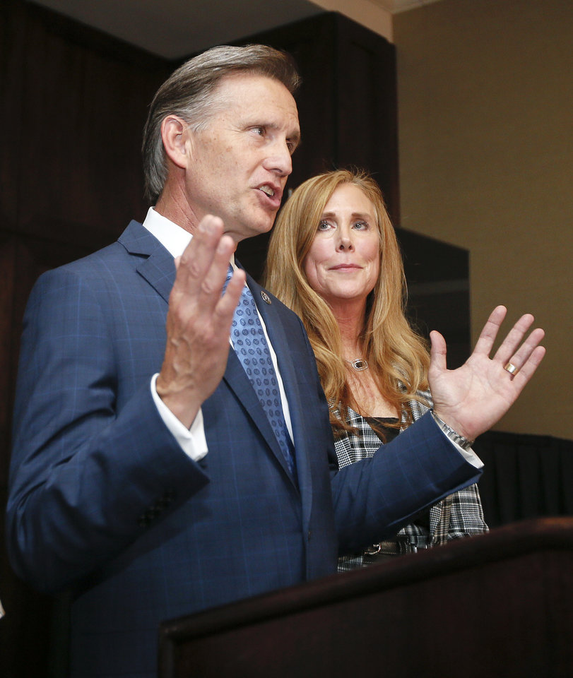 Photo - Attorney General Mike Hunter speaks to supporters next to his wife, Cheryl, during his watch party at the Renaissance Waterford Oklahoma City Hotel in Oklahoma City, Tuesday, June 26, 2018. Photo by Nate Billings, The Oklahoman