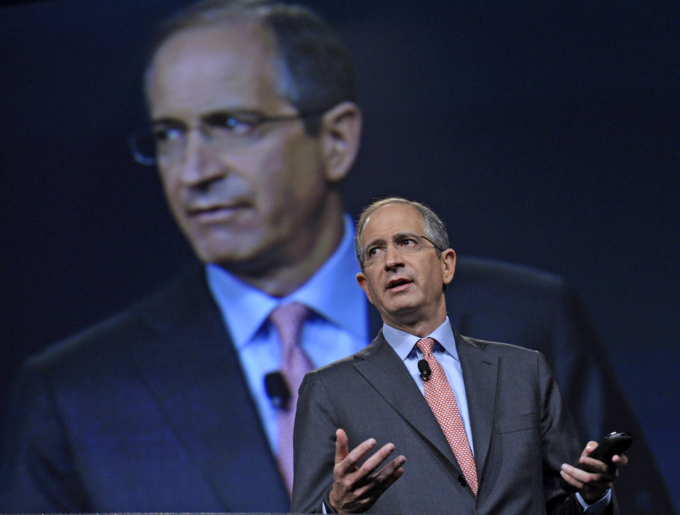 Photo - FILE - In this June 11, 2013 file photo, Comcast Corp. CEO Brian Roberts speaks during The Cable Show 2013 convention in Washington. Roberts was the tenth highest paid CEO in 2013 at $31.4 million, as calculated by The Associated Press and Equilar, an executive pay research firm. (AP Photo/Susan Walsh, File)