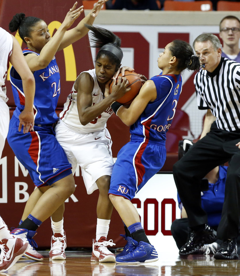Kansas Jayhawks\' CeCe Harper (24) and Angel Goodrich (3) try to take the ball from Oklahoma Sooner\'s Aaryn Ellenberg (3) in the second half as the University of Oklahoma Sooners (OU) defeat the Kansas Jayhawks 85-77 in NCAA, women\'s college basketball at The Lloyd Noble Center on Saturday, March 2, 2013 in Norman, Okla. Photo by Steve Sisney, The Oklahoman