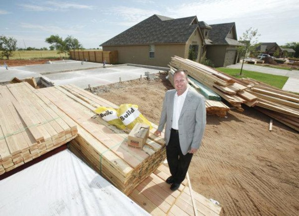 Photo - Home builder Steve Allen of Allenton Homes & Development stands at the site of one of his homes under construction at 6917 NW 161.  PAUL HELLSTERN - The Oklahoman
