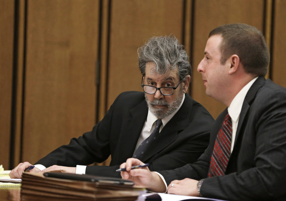 Bobby Thompson, left, talks with his defense attorney Joseph Patituce Monday, Sept. 30, 2013, in court in Cleveland. Thompson, one-time fugitive heads to trial on charges of masterminding a $100 million multi-state fraud under the guise of helping Navy veterans. The defendant calls himself Bobby Thompson, but authorities identified him as 67-year-old Harvard-trained lawyer and former military intelligence officer John Donald Cody. (AP Photo/Tony Dejak)