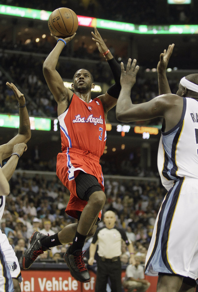Photo - Los Angeles Clippers' Chris Paul (3) heads to the hoop agains the Memphis Grizzlies during the first half of Game 3 in a first-round NBA basketball playoff series, in Memphis, Tenn., Thursday, April 25, 2013. (AP Photo/Danny Johnston)