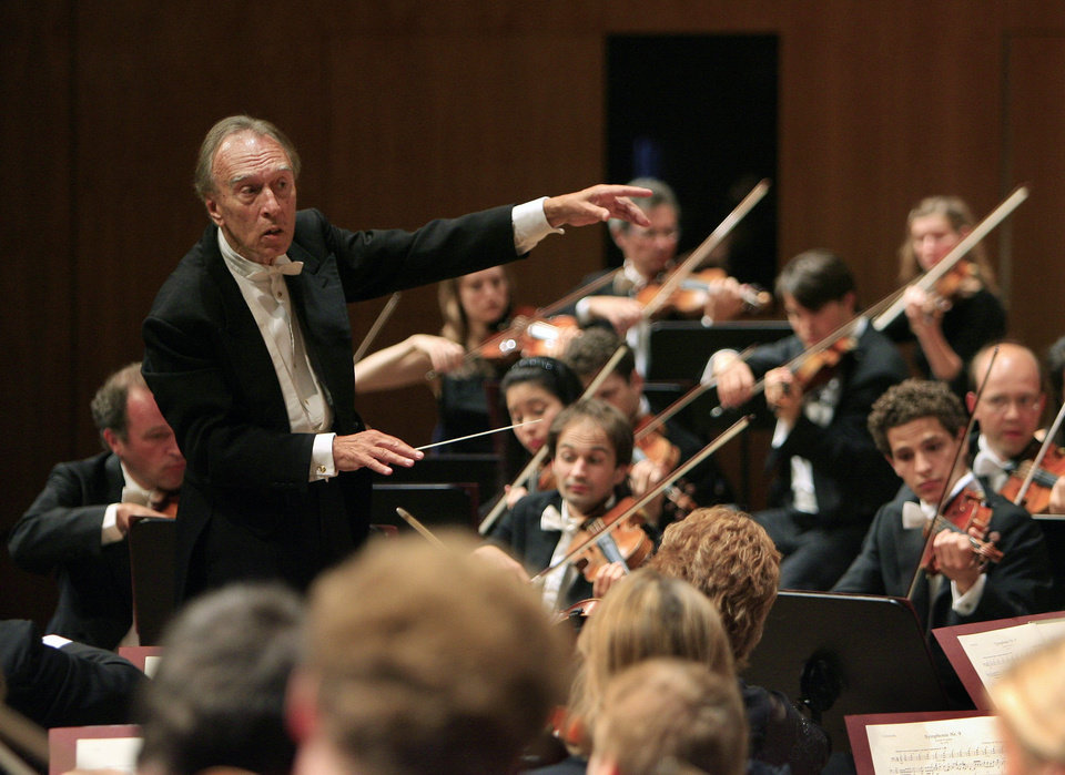 Photo - FILE - In this Aug. 10, 2007 filer, conductor Claudio Abbado, left, conducts his orchestra during the opening concert of the Lucerne Festival in Lucerne, Switzerland. Claudio Abbado, a star in the great generation of Italian conductors who was revered by musicians in the world's leading orchestras for developing a strong rapport with them while still allowing them their independence, has died Monday, Jan. 20, 2104. He was 80. Abbado made his debut in 1960 at La Scala in his home city of Milan and went on to be its musical director for nearly 20 years. Among his many other stints were as musical director of the Vienna State Opera, the Berlin Philharmonic and the London Symphony Orchestra and chief guest conductor of the Chicago Philharmonic. Even as he battled illness in his later years, Abbado founded his own all-star orchestra in Lucerne, Switzerland. (AP Photo/Eddy Risch, Keystone)