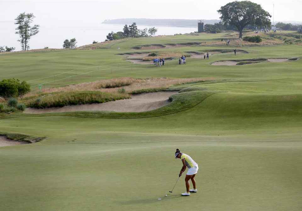 Photo - Mariajo Uribe of Colombia putts on the first green during the first round at the U.S. Women's Open golf tournament at Sebonack Golf Club in Southampton, N.Y., Thursday, June 27, 2013.   (AP Photo/Seth Wenig)