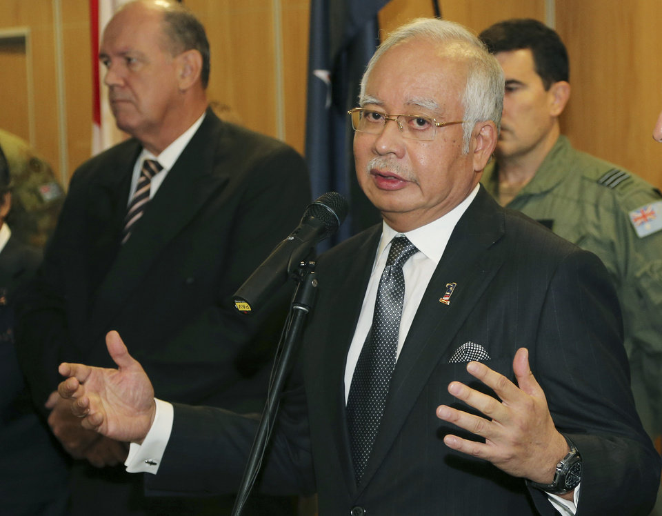 "Photo - Malaysian Prime Minister Najib Razak speaks at a breakfast with crew members from different countries involved in the search for wreckage and debris of the missing Malaysia Airlines MH370 in Perth, Australia, Thursday, April 3, 2014. In a hastily called speech, Malaysian Prime Minister Najib Razak announced that an unprecedented analysis of satellite signals concluded that Malaysia Airlines Flight 370 ""ended"" deep in the Indian Ocean, far from any possible refuge for the 239 souls aboard. (AP Photo/Rob Griffith, Pool)"