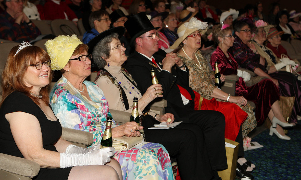 Photo - People drink champagne as they watch the royal wedding in London, at the Palace Theatre in London, Ontario, early Friday, April 29, 2011.  (AP Photo/The Canadian Press, Dave Chidley) ORG XMIT: DJC109