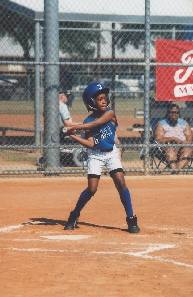 Photo - Courtney Walker plays in a softball game. PHOTO PROVIDED