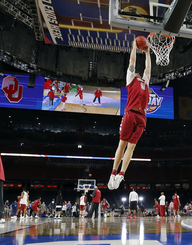 Photo - Oklahoma's Ryan Spangler (00) dunks the ball during practice on Final Four Friday before the national semifinal between the Oklahoma Sooners and the Villanova Wildcats in the NCAA Men's Basketball Championship at NRG Stadium in Houston, Friday, April 1, 2016. OU will play Villanova in the Final Four on Saturday. Photo by Nate Billings, The Oklahoman