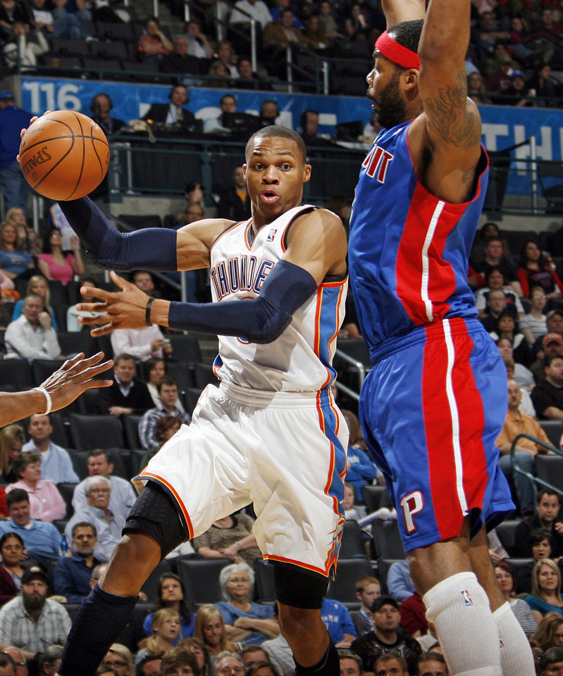 Russell Westbrook (0) of Oklahoma City passes the ball away from Detroit's Chris Wilcox (9) during an NBA basketball game between the Oklahoma  City Thunder and the Detroit Pistons at the OKC Arena in Oklahoma City, Friday, March 11, 2011. Photo by Nate Billings, The Oklahoman