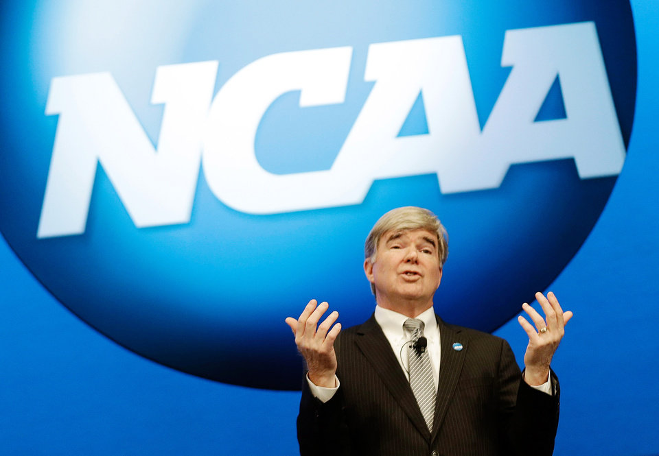 Photo - FILE - In this Jan. 17, 2013, file photo, NCAA President Mark Emmert speaks at the organization's annual convention in Grapevine, Texas. Barely a month ago, the NCAA was shamed into apologizing for trying to rig its own investigation into funny business at the University of Miami. According to a new report, that apology didn't go nearly far enough. (AP Photo/LM Otero, File(