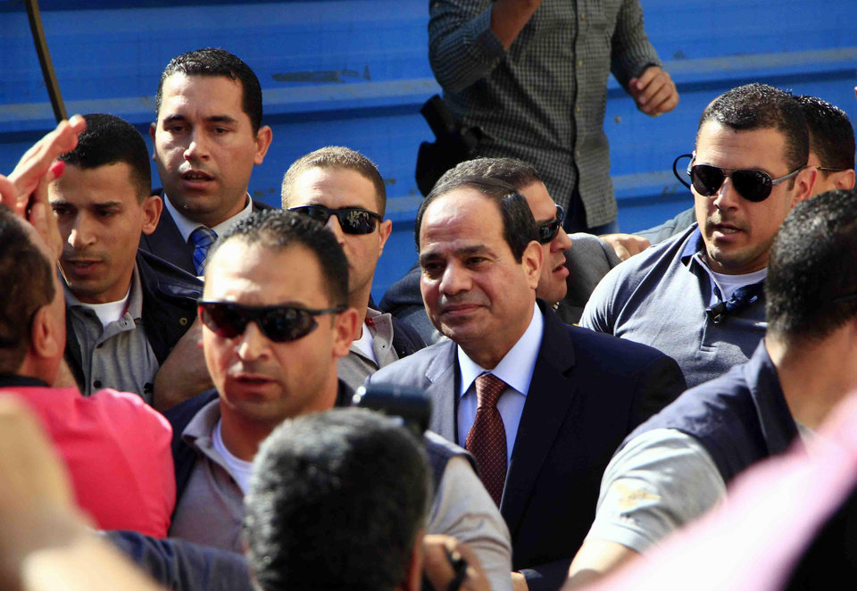 Photo - Presidential hopeful Abdel-Fattah el-Sissi arrives to a polling site to cast his ballot on the first day of voting in Cairo, Egypt, Monday, May 26, 2014.  Egyptians are choosing a new president on Monday in an election that comes nearly a year after the military's ouster of the nation's first freely elected president, the Islamist Mohammed Morsi. The man who removed Morsi, retired military chief Field Marshal Abdel-Fattah el-Sissi, is practically assured of a victory in the vote, which is being held over two days, Monday and Tuesday.(AP Photo/Lobna Tarek, El Shorouk Newspaper) EGYPT OUT