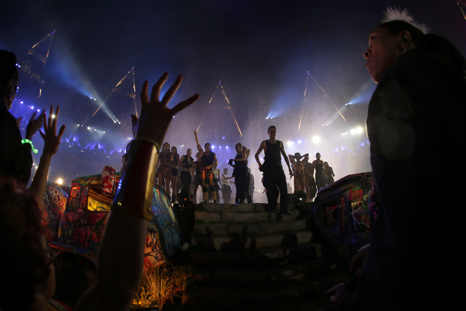 Photo -   In this picture taken with a fish-eye lens artists perform during the closing ceremony for the 2012 Paralympics games, Sunday, Sept. 9, 2012, in London. (AP Photo/Matt Dunham)