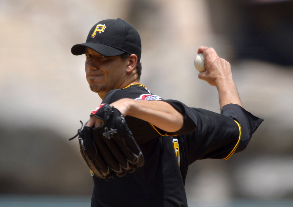 Photo - Pittsburgh Pirates starting pitcher Charlie Morton throws to the plate during the first inning of their baseball game against the Los Angeles Angels, Sunday, June 23, 2013, in Anaheim, Calif. (AP Photo/Mark J. Terrill)