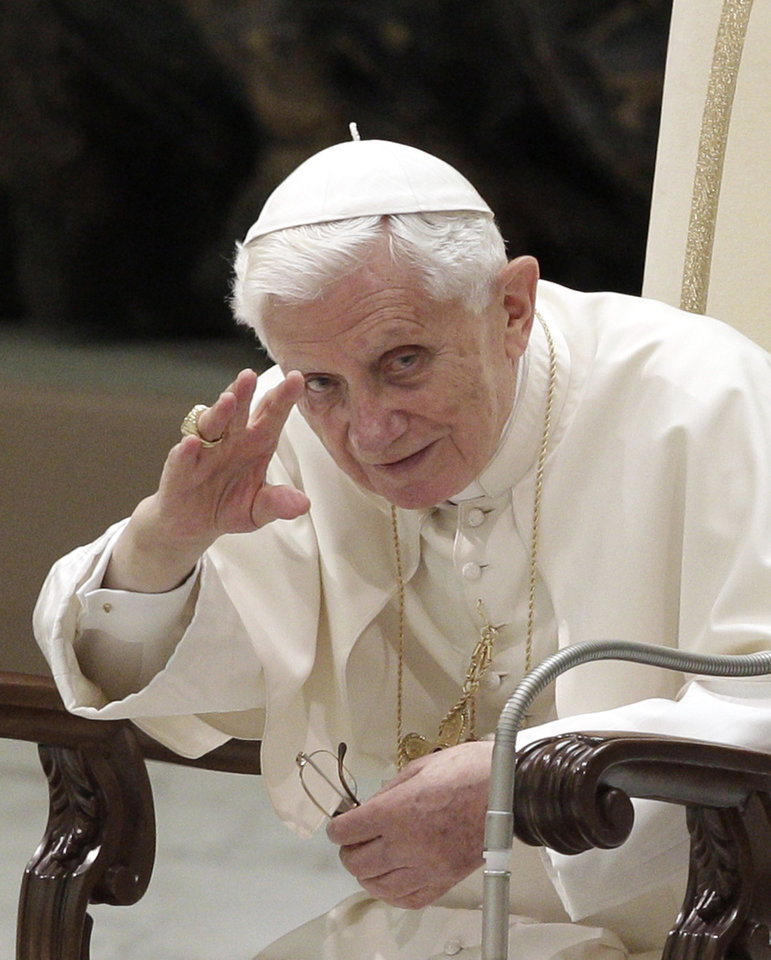 Photo -   Pope Benedict XV waves during his weekly general audience in the Paul VI hall at the Vatican, Wednesday, Sept. 12, 2012. (AP Photo/Riccardo De Luca)