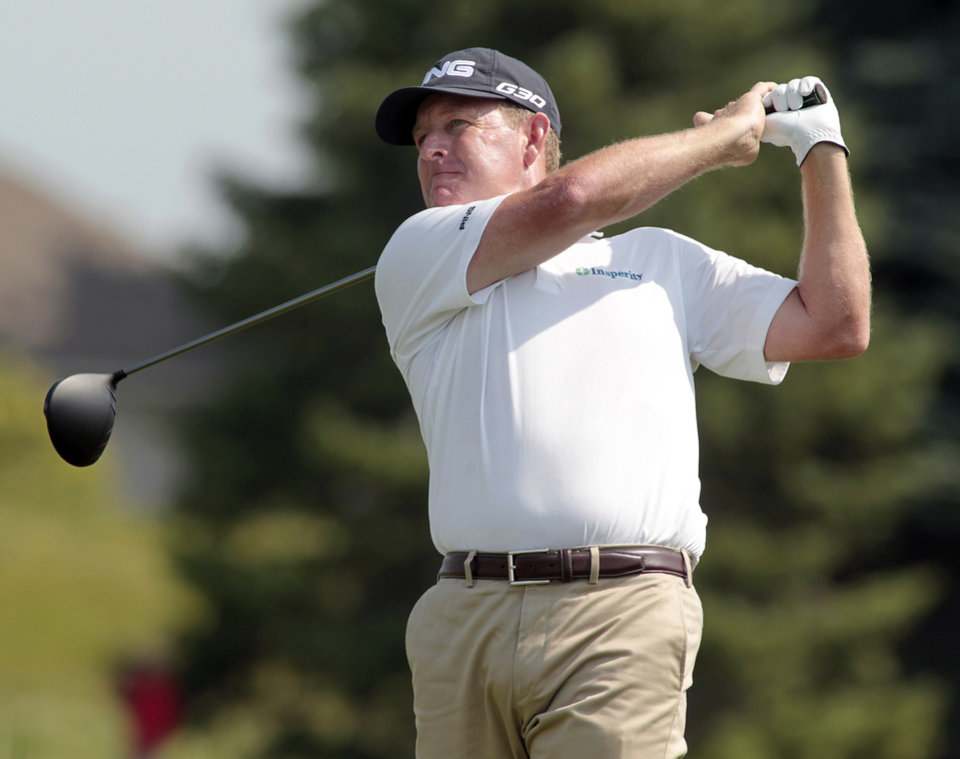 Photo - Jeff Maggert hits his drive off the first tee during the third round of the Champions Tour 3M Championship golf tournament at TPC Twin Cities in Blaine, Minn., Sunday, Aug. 3, 2014. AP Photo/Paul Battaglia)