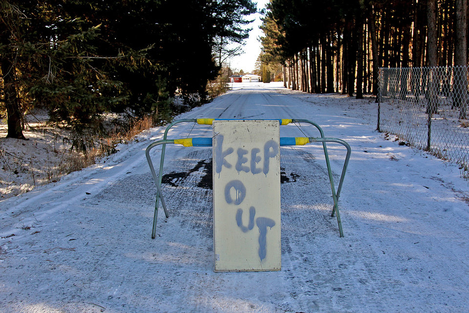 Photo -   A keep out sign stands at the property of Byron David Smith, in Little Falls, Minn., Monday, Nv. 26, 2012. Smith, a 64-year-old Minnesota homeowner who shot two teenagers in the midst of an apparent Thanksgiving Day break-in told authorities he feared they had a weapon, but acknowledged firing