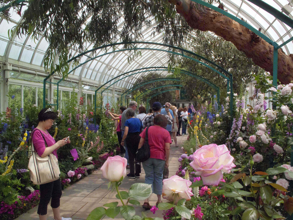 "In this May 26, 2012 photo, visitors to the New York Botanical Garden in New York walk through  ""Monet's Garden,"" which evokes the impressionist artist Claude Monet�s garden at Giverny, his home in France, from 1883 until his death in 1926. The exhibit runs through Oct. 21. (AP Photo/Ray Stubblebine) <strong>Ray Stubblebine - AP</strong>"