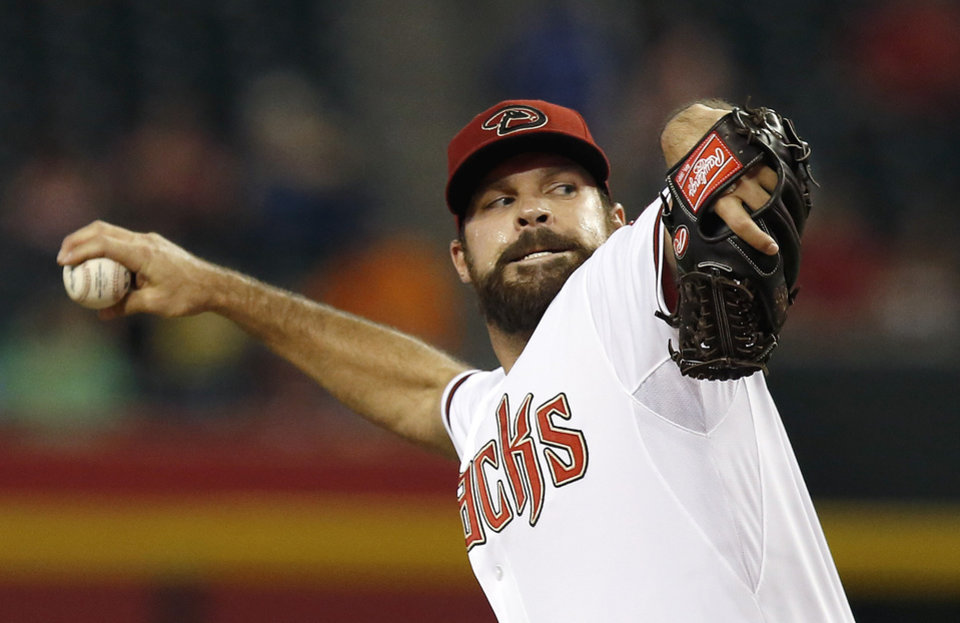 Photo - Arizona Diamondbacks' Josh Collmenter throws against the Houston Astros during the first inning of a baseball game on Monday, June 9, 2014, in Phoenix. (AP Photo/Ross D. Franklin)