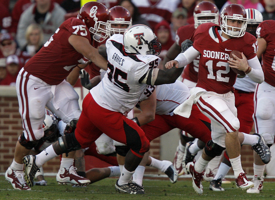 Photo - Oklahoma's Landry Jones (12) runs the ball out of the pocket during the second half of the college football game between the University of Oklahoma Sooners (OU) and the Texas Tech Red Raiders (TTU) at the Gaylord Family-Oklahoma Memorial Stadium on Saturday, Nov. 13, 2010, in Norman, Okla.  Photo by Chris Landsberger, The Oklahoman