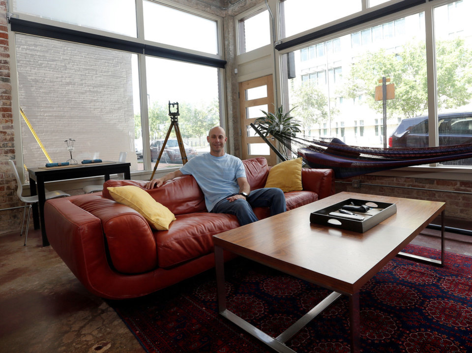 Robert Lewis shows the living area of his home, a former commercial building, at 711 N Hudson. <strong>SARAH PHIPPS - The Oklahoman</strong>