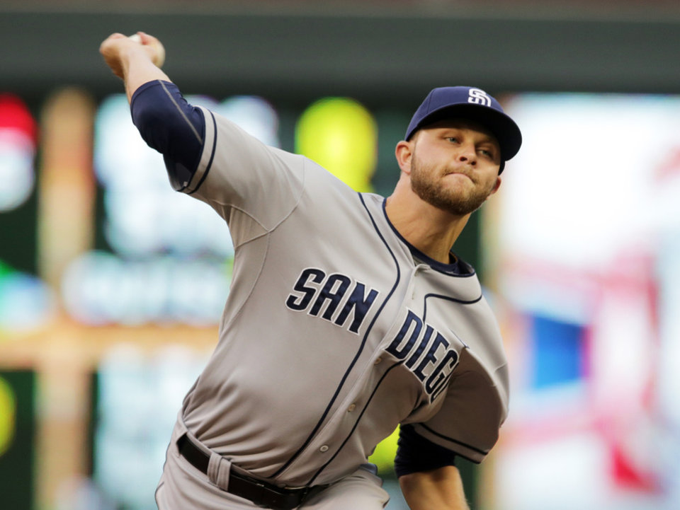 Photo - San Diego Padres pitcher Jesse Hahn throws against the Minnesota Twins in the first inning of a baseball game, Tuesday, Aug. 5, 2014, in Minneapolis. (AP Photo/Jim Mone)