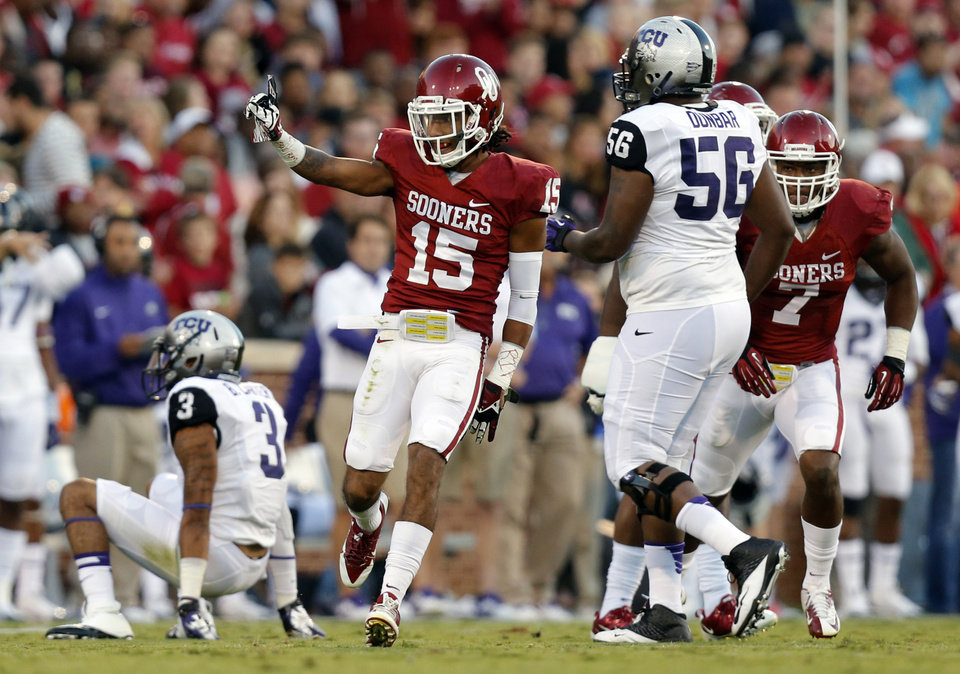 Photo - Oklahoma's Zack Sanchez (15) reacts after a stop during the college football game between the University of Oklahoma Sooners (OU) and the Texas Christian University Horned Frogs (TCU) at the Gaylord Family-Oklahoma Memorial Stadium on Saturday, Oct. 5, 2013 in Norman, Okla.   Photo by Chris Landsberger, The Oklahoman