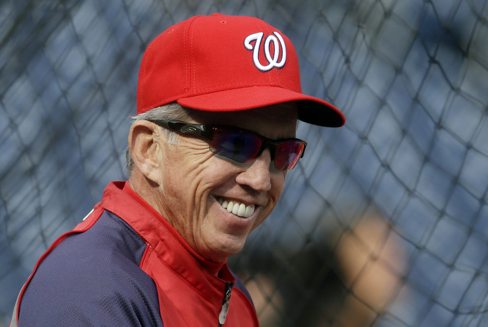 FILE - In this Oct. 10, 2012, file photo, Washington Nationals manager Davey Johnson watches his players take batting practice before Game 3 of the National League division baseball series against the St. Louis Cardinals in Washington. Johnson was voted as the National League Manager of the Year on Tuesday, Nov. 13, 2012. (AP Photo/Pablo Martinez Monsivais, File)