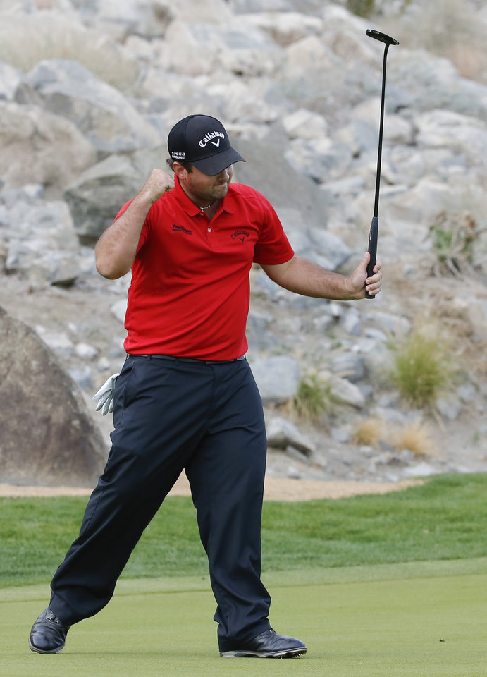 Photo - Patrick Reed celebrates a birdie on the 15th hole during the final round of the Humana Challenge golf tournament on the Palmer Private course at PGA West,Sunday, Jan. 19, 2014 in La Quinta, Calif. (AP Photo/Matt York)