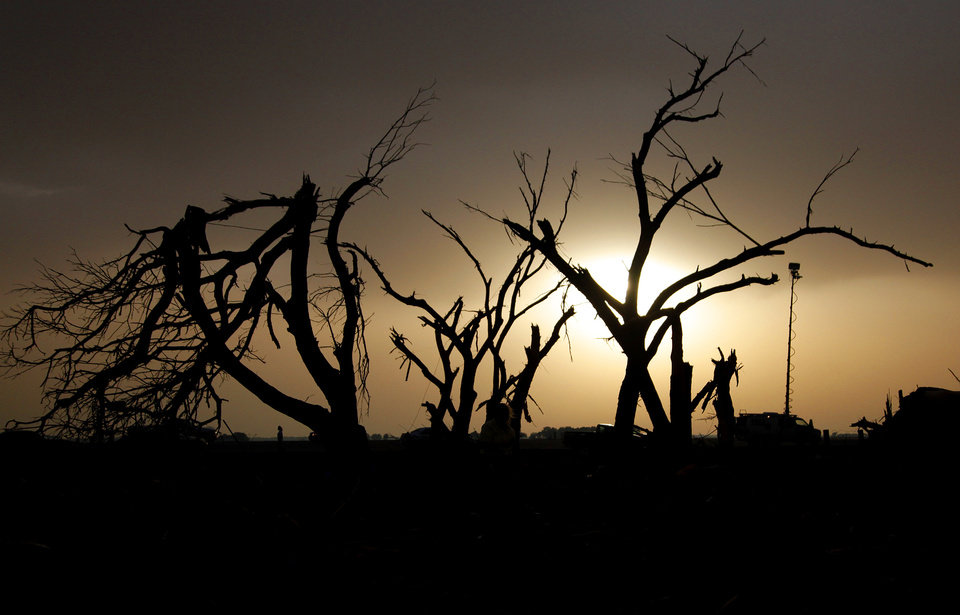 Splinter trees in the yard of Tom Chronister's home are silhouetted after being destroyed north of El Reno, Tuesday, May 24, 2011. Photo by Chris Landsberger, The Oklahoman ORG XMIT: KOD
