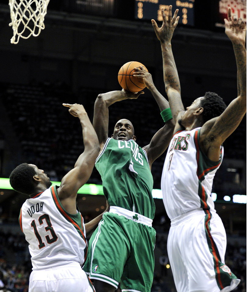 Milwaukee Bucks' Ekpe Udoh (13) and Larry Sanders defend as Boston Celtics' Kevin Garnett center, shoots the ball during the first half of an NBA basketball game, Saturday, Nov. 10, 2012, in Milwaukee. (AP Photo/Jim Prisching)