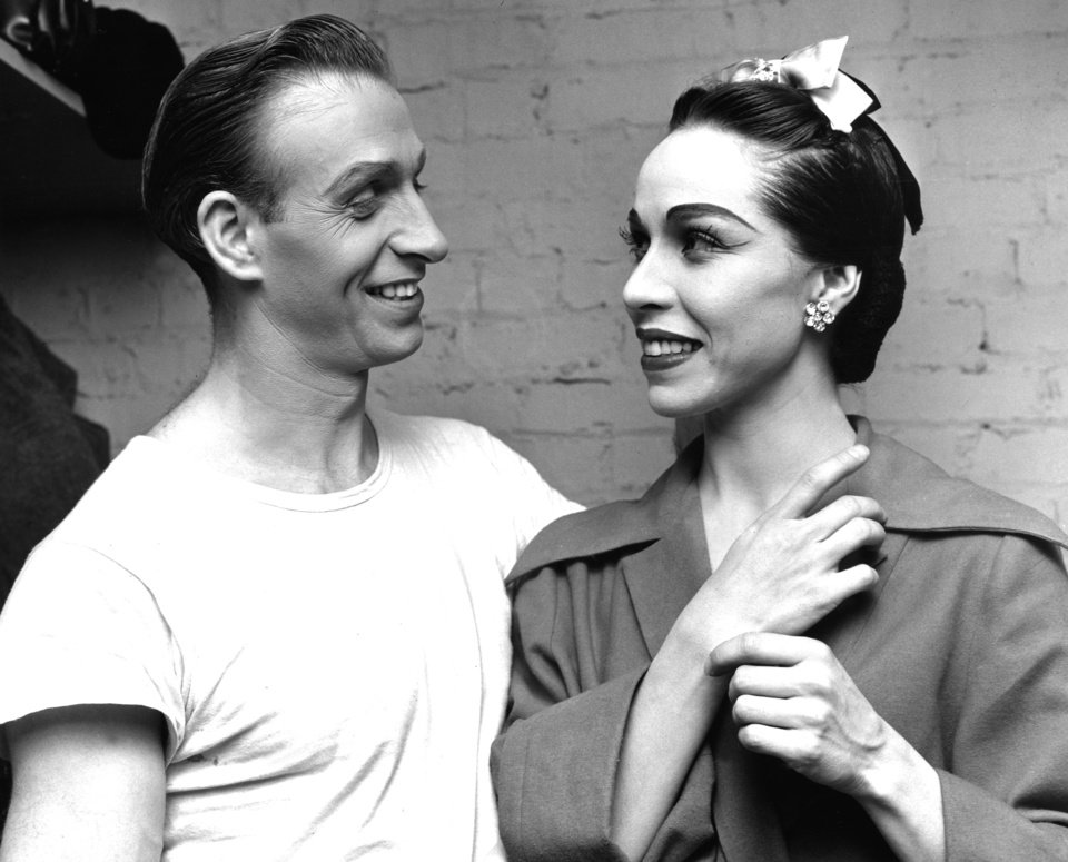 "BALLERINAS: Oklahoma Indian ballerina Maria Tallchief (right) and premier danseur Frederic Franklin backstage in Tulsa Wednesday night as the duo prepares for their ""Swan lake"" performance. Staff photo by Bob Albright taken 12/15/54."