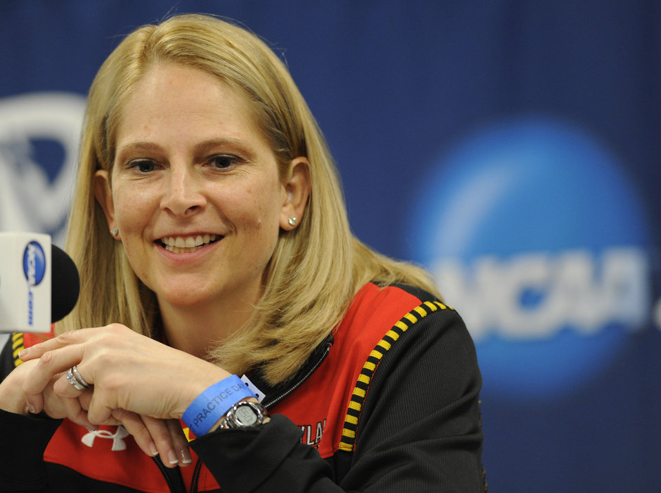 Photo - Maryland head coach Brenda Fresesmiles during a news conference before the first round of the NCAA women's college basketball tournament, Saturday, March 22, 2014. in College Park, Md.(AP Photo/Gail Burton)